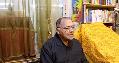 Cyrus Ryan giving a talk in a London bookshop